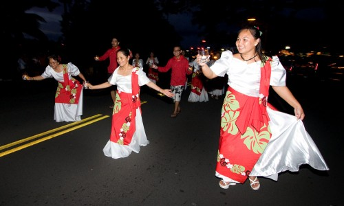 The Hilo Visayan Club dances their way through Hilo during the Lehua Jaycees Island Style Christmas parade.