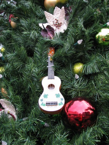 The holiday tree at Emma's Square include ukulele, balls and floral decorations.