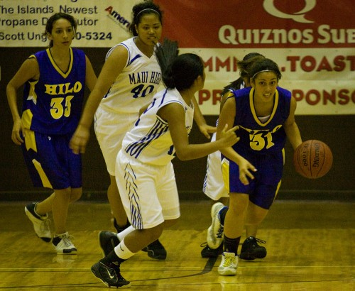 Hilo Viking Chelsea Cooper31) breaks away with Maui's Chynna Ramelb (12) moving in to get the ball back during second half action in Onizuka Gym at the Konawaena campus. (Photo by Baron Sekiya/Hawaii247.com)
