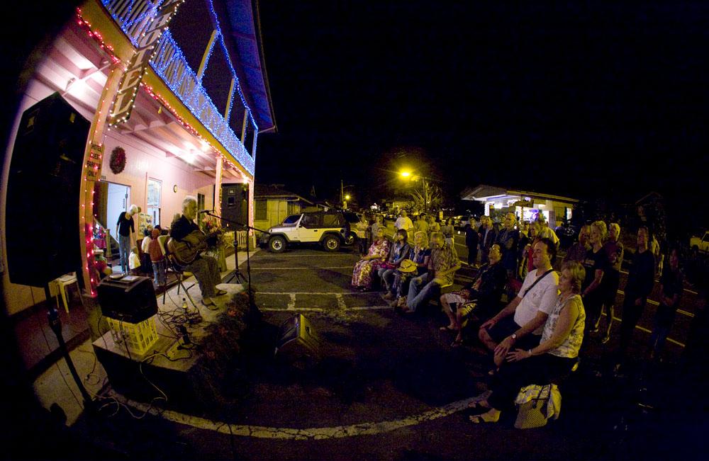 The Holualoa Music & Light Festival The Big Island's John Keawe entertains on slack-key guitar for the crowd in front of historic Kona Hotel during the Holualoa Music & Light Festival.
