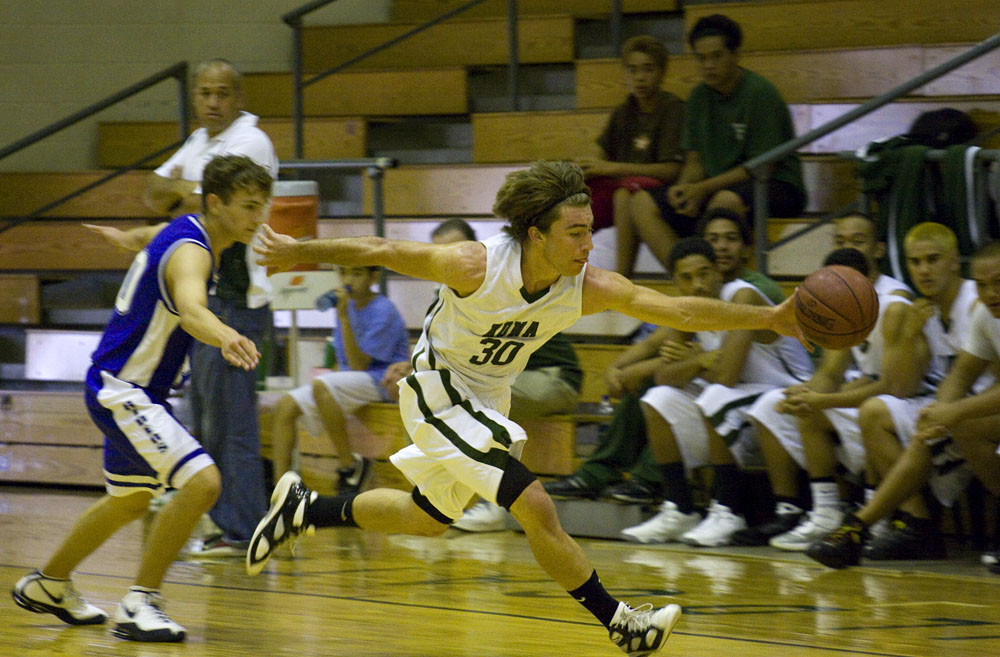 Konawaena Wildcat Sam Unger (30) steals the ball from Kealakehe during the first half of action against Kealakehe at last game of the Winter Basketball Classic.