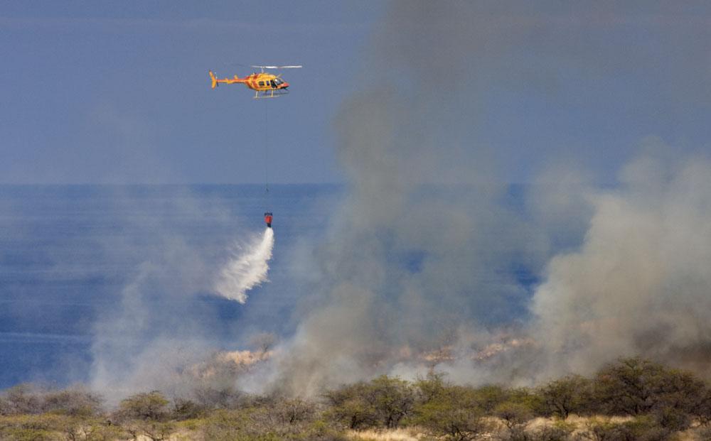 Hawaii County Fire Department's Chopper Two fights two brushfires at Makalawena near Kua Bay.