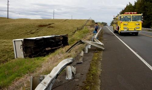 The Earl's Snack Shop truck overturned along Highway 19 near Waimea Country Club Thursday morning (Photos by Baron Sekiya/Hawaii247.com)