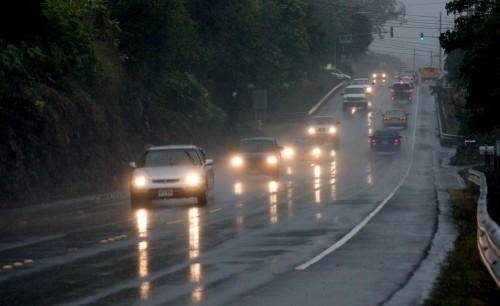 Cars head north along the Mamalahoa Highway (Hwy 190) in North Kona as a rainstorm drenched the area Thursday.