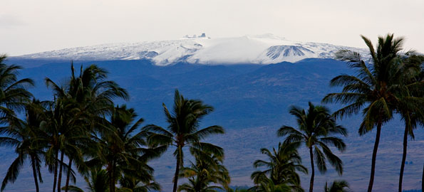 "Friday morning dawn revealed a blanket of white atop Mauna Kea. One to two feet of fresh snow blanketed the summit, a present from Poli'ahu deposited during the night. The storm and the fresh snowfall immediately becomes the subject of conversation around town, one question to be asked... ""Is the road open?"""