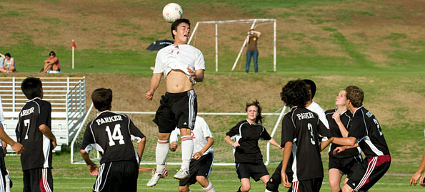 Hawaii Preparatory Academy's Jonathan Himalaya goes up for a header in a match against the Parker Bulls in Waimea at the HPA campus.