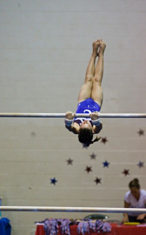 Hadley Beach, of the Kona Aerials, prepares to dismount from the uneven bars. (Photo by Susan Dabritz/SeaPics.com)