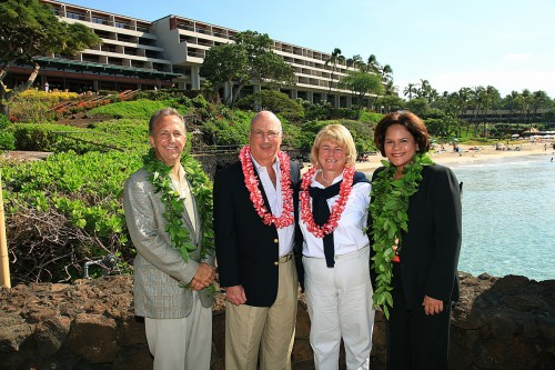 Welcoming the resorts first guests, Steve and Jane Gerard were (from left) hotel general manager Jon Gersonde, Steve Gerard, Jane Gerard and hotel manager Noelani Cashman-Aiu. The Gerards are from New York City and have been visiting The Mauna Kea for the last 27 years. (Photo courtesy of The Mauna Kea)