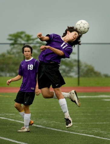 Makua Lani's Andew Dong (11) goes up for a header with fellow Lion Michael Warnecke (19) by his side during BIIF soccer action against Kamehameha-Hawaii in Keaau Saturday afternoon. The game played to a 1-1 tie.