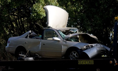 One of the vehicles being taken away from the accident scene.