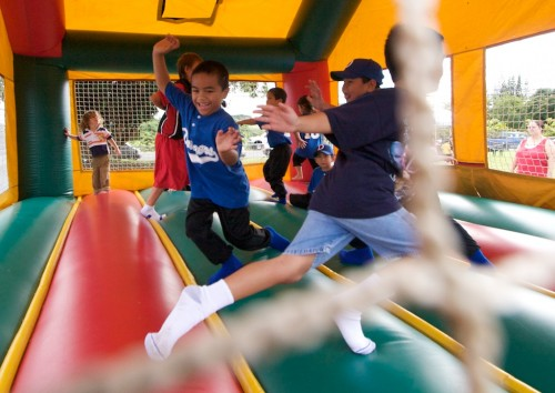 Kids jump in the party bouncer during the Family Fun Day at Kurtistown Park.
