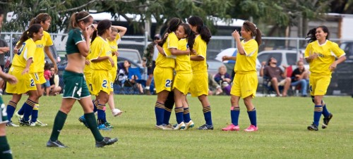 The Hilo Viking girls celebrate on their 4-2 win as the regular season champion against the Konawaena Wildcats in Hilo.