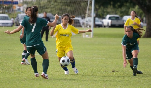 Hilo Viking Nathalie Orevillo (2), center, works through a pair of Konawaena Wildcat players Anuhea Fleming (7), left, and Kauanani Wall (4) during the BIIF regular season title game in Hilo.