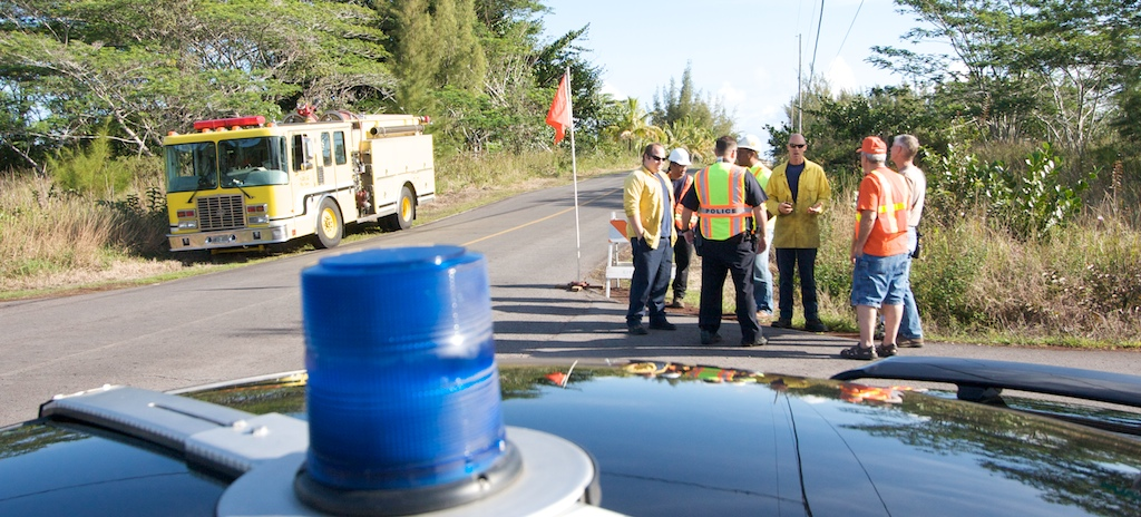 Police, CERT team members, fire and other county workers stand at the intersection of Paradise and 2nd during the tsunami exercise.