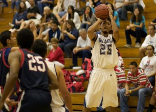 Waiakea Warrior Charles Tatsuhara (25) aims and fires off a shot against the Keaau Cougars in BIIF basketball action.