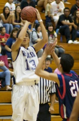 Taking a jumper is Waiakea Warrior Isaak Janado (13).