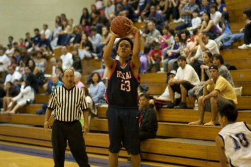 Keaau's Jalani Young (23) shoots against Waiakea during boys basketball action.