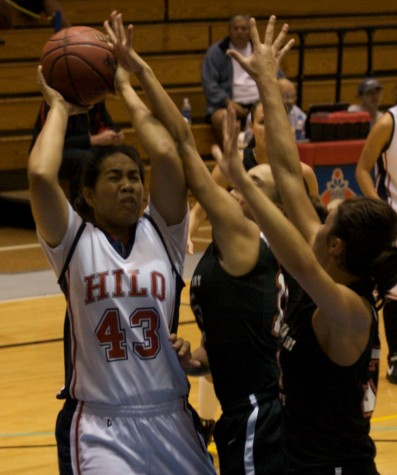 UH-Hilo's Hotia Vaaimamao (43) battles for the rebound against Academy of the Arts players during action in Hilo.