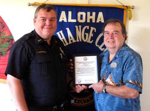Aloha Exchange Club President Winston Churchill, right, presents an 'Officer of the Month' award to officer Joseph Passmore.