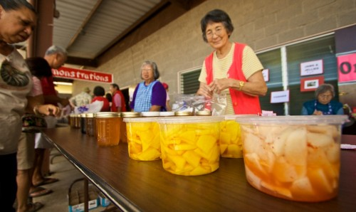 Fujiko Dochin and Alice K. Yamaguchi sell jams and preserves at Kamuela Hongwanji during the Waimea Cherry Blossom Heritage Festival. The event featured arts, crafts, entertainment, demonstrations and lots of food.