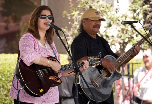 Darlene Ahuna entertains at Parker Ranch Shopping Center during the Cherry Blossom festivities.