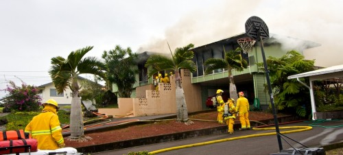 Firefighters battle a structure fire on Hiluhilu St. in Hilo Wednesday afternoon.