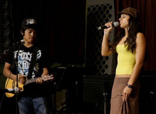 "Nico Eder, left, accompanies Ari Graham sings ""Waiting on the World to Change"" during the Keaau Variety Show."