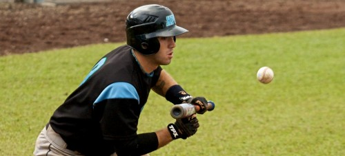 Hawaii Pacific University's Alex Agortsas squares to bunt during the first game of a doubleheader against UH-Hilo Friday afternoon. HPU won this first game 5-2 but dropped the second game 3-4 at Wong Stadium.