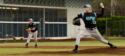 HPU pitcher Caelan O'Meara (33) fires a pitch off the mound in the second game of a doubleheader against UH-Hilo at Wong Stadium. The Vulcans lost the first game 2-5 and won this second game 4-3 against the Sea Warriors.