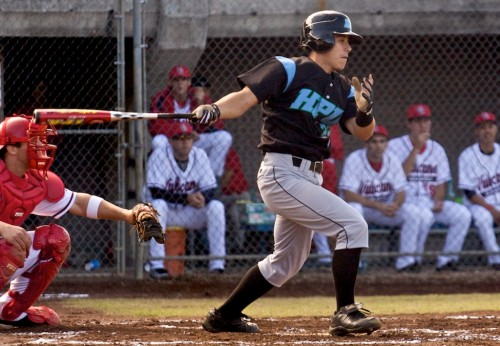 HPU's Lester Akeo gets a hit during action against the Vulcans at Wong Stadium.