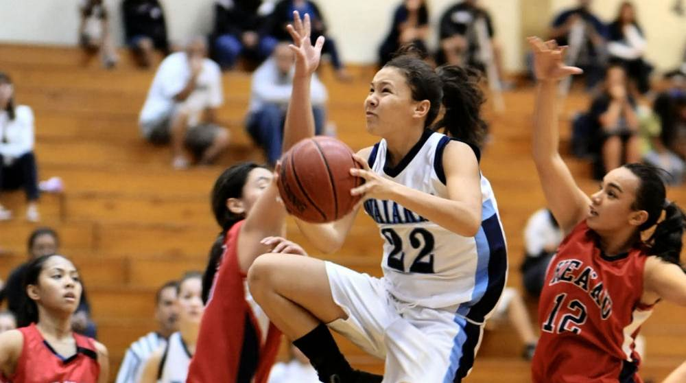 The girls' basketball teams for Waiakea and Keaau conspired to imitate Sunday's Super Bowl as their game was decided in the last few seconds.