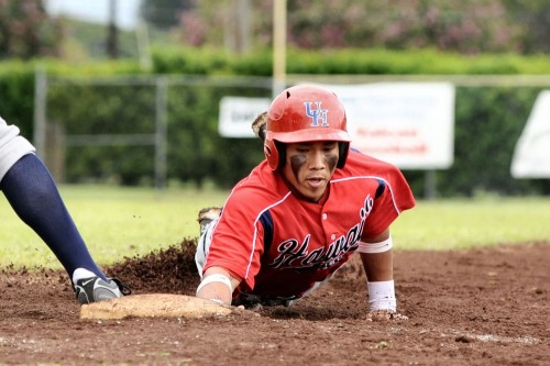Hilo's Ronel Trias dives safely back into first base. The speedy leadoff hitter went 1 for two scoring two runs.