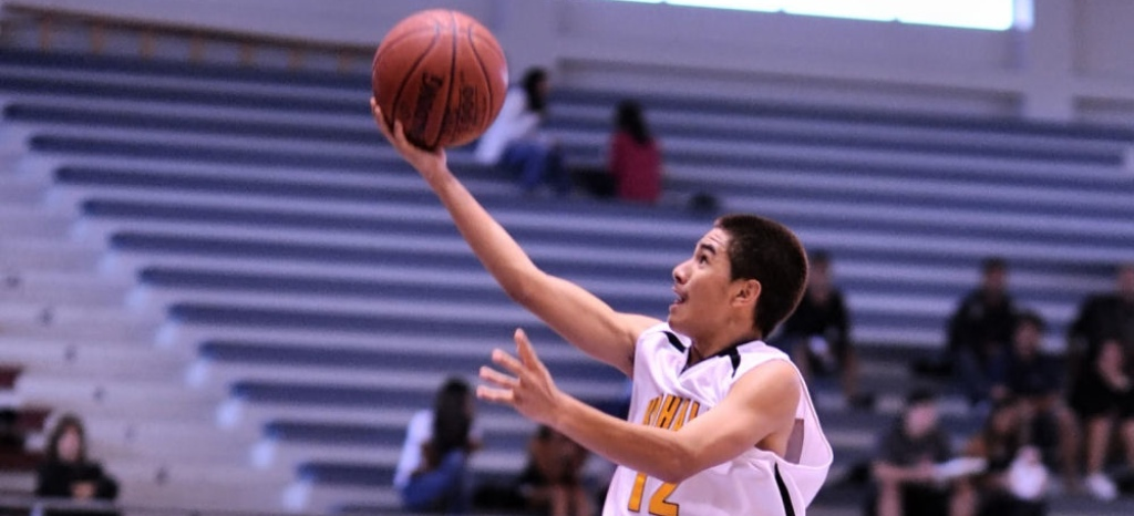 Brandon Bautista of Kohala flys past the Kau defender for his game high 18 points.