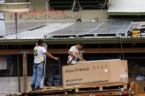 Photovoltaic panels being installed at Pahoa Cash & Carry. Photo by Baron Sekiya/Hawaii247.com