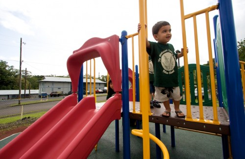 Tai Rapoza, two years-old, of Montessori Country School tries out the new playground equipment in Pahoa.