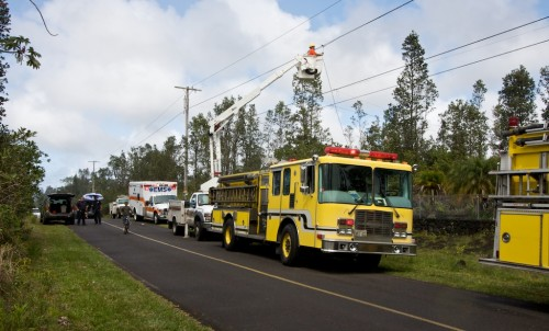 HELCO crews worked on power lines after a structure fire on Ainaloa Drive. The street was closed to traffic due to emergency vehicles.