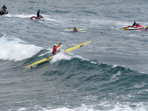 OC-1 paddler Sheila Cadaoas powers over a wave during the Hurricane Keokea Invitational canoe race. Cadaoas finished with a time of 1:32:41.5. Photo by Vytas Katilius/Special to Hawaii247.com