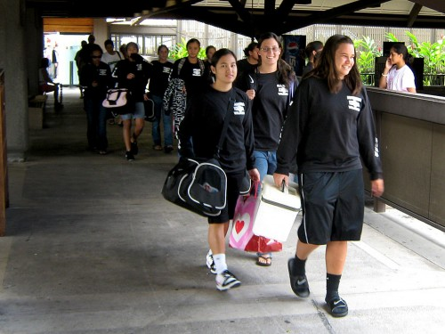 The state champion girls high school Êbasketball team Konawaena Wildcats arrive Sunday at the Kona International Airport. In front, from left to right, are Kara Hanato-Smith, Anuhea Wall and Kimberly Brown.