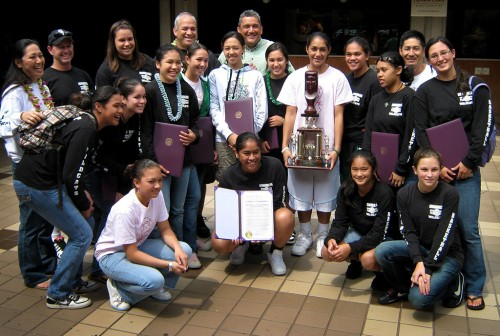 The Konawaena Wildcats share a moment with Mayor Billy Kenoi. Members of the team and coaches were presented by the County of Hawaii with proclamations recognizing their achievement.