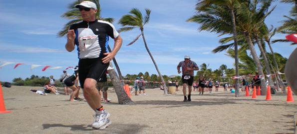 Athletes give a little extra effort as they approach the finish line at the Waikoloa Lavaman Triathlon. (Hawaii247.com photo by Karin Stanton)