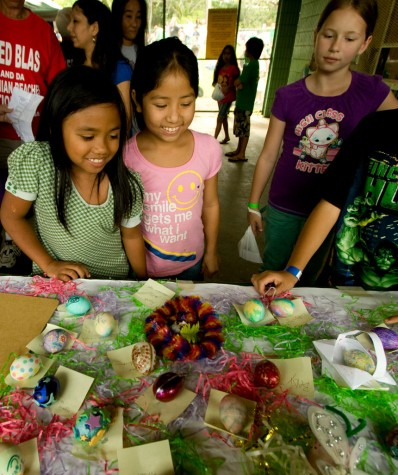 Kids look over the 'most creative' category of the Easter egg decorating contest.