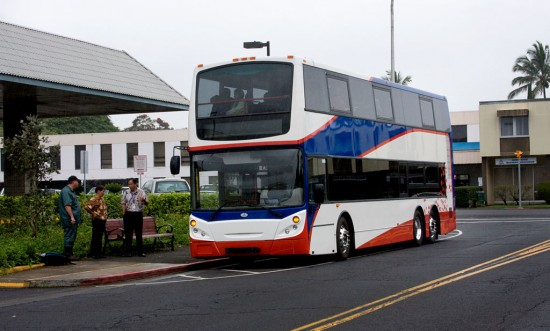 An Enviro 500 double-decker bus on Aupuni Street in Hilo is ready for a demonstration run for media and county officials.