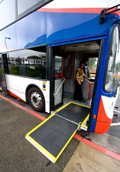 The double-decker bus has a fold out ramp for wheelchair accessibility. The bus would be outfitted with bike racks in the front as current Hele-On buses.
