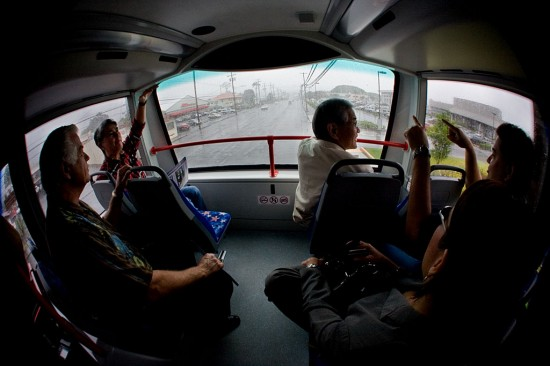The upper deck of the bus provides a panoramic view out of the front for passengers.
