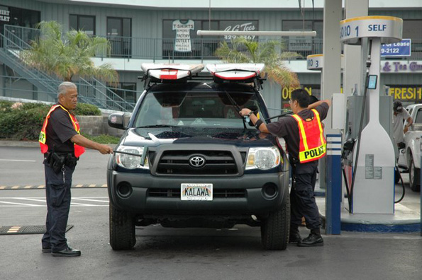 Big Island police officers bust out their power cleaning moves during a car wash fundraiser for Special Olympics West Hawaii. (Photo by KC Strand/couresty of Special Olympics West Hawaii)