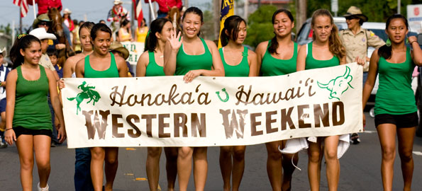 The Honokaa cheer squad heads down Mamane Street in the Honokaa Western Week Paniolo Parade