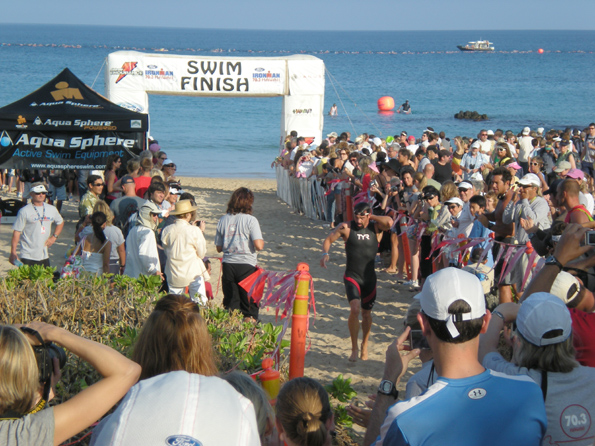 John Flanagan, of Honolulu, was first out of the water.  (Hawaii247.com photo by Karin Stanton)