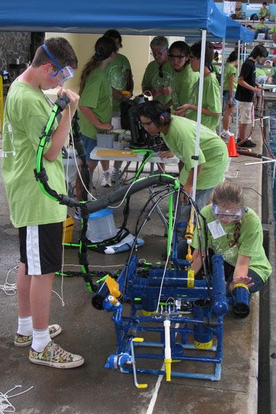Kealakehe Intermediate School ROV team preparing for launch of their ROV at poolside