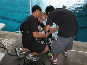 Students from Mauna Kea Educational Academy dealing with an electrical problem aboard their ROV