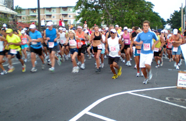 Runners take off at the start of  the Kona Marathon on Sunday, June 28 on Alii Drive outside the Outrigger Keauhou Beach Hotel. (Hawaii247.com photo by Karin Stanton)